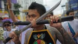 sword through cheek