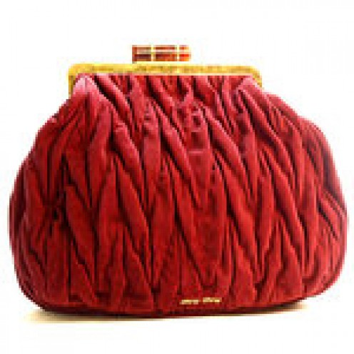 Miu Miu's oversized clutch bag with rich texture.
