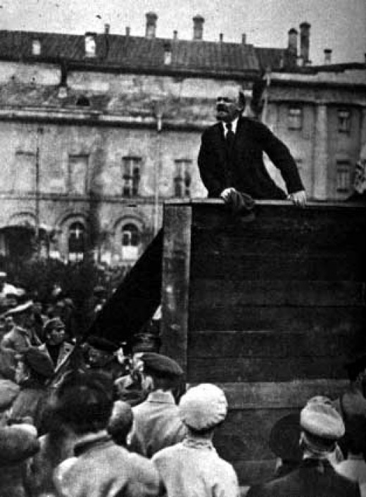 Lenin giving a speech to the troops at the on, May 5, 1920 with Trotsky in foreground. Taken in front of Moscow's Bolshoi Theater. (note that this is only the left half of the original picture; the right half featured Trotsky, so the picture got slic