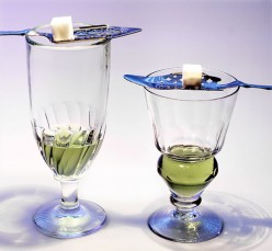 Two absinthe glasses. Left, Swirl glass. Right Pontarlier reservoir glass.