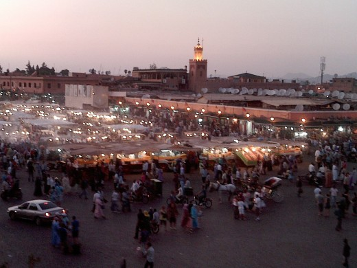 Looking down on Djemaa el-Fna at dusk with smoke coming up from the evening food stalls