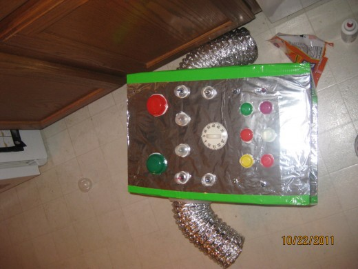 the body with arms, and lights, used gumball containers to cover the lights and use for bottons on the body also timer knob