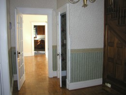 Looking from entry way to dining room to kitchen