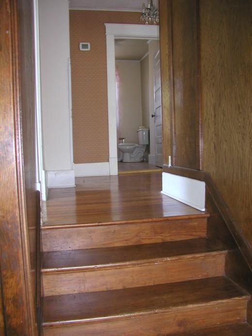 Upper front stairway landing..