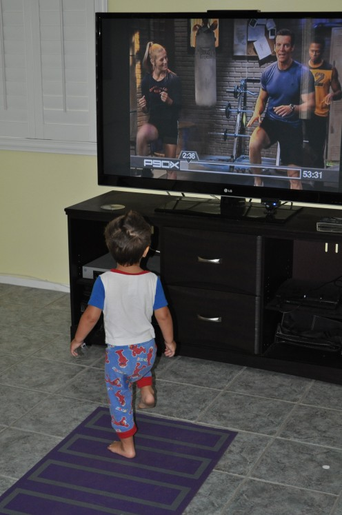 Here is Max doing a little morning workout with Tony Horton.