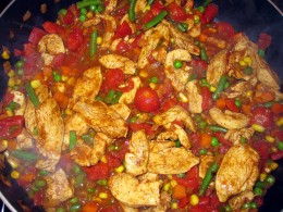 Cooking the chicken and vegetables for fajitas