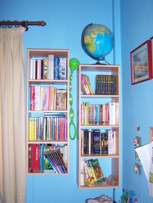 Books in the childrens bedroom - I daren't show you the piles on the floor too.