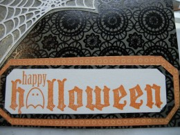 Halloween stamp adhered to layers on card