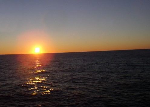 Sunset from way out in the Atlantic Ocean.  I took this picture while on a cruise ship, knowing it would rise again with a new and different day. Our world is already very different due to new developments in technology and communications.
