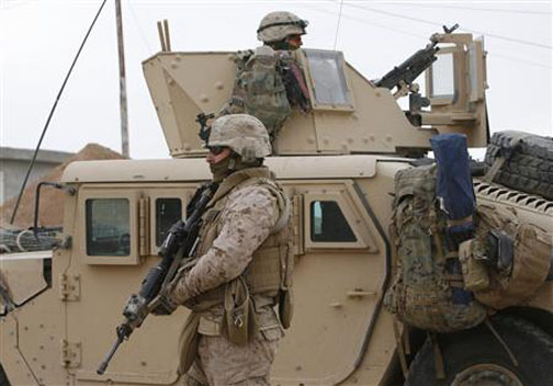 U.S. Marines of Mobile Assault Company, 1st Battalion that provide security to a U.S. State Department election observers team secure a polling station in Sinjar, 390 km (240 miles) northwest of of Baghdad January 31, 2009.