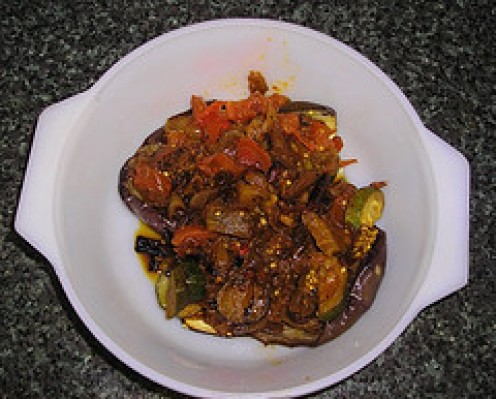 Eggplant or aubergine skins stuffed with fried onion, eggplant, courgette and tomatoes