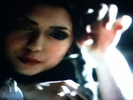 Katherine dangles a mouse over a comatose Michael.