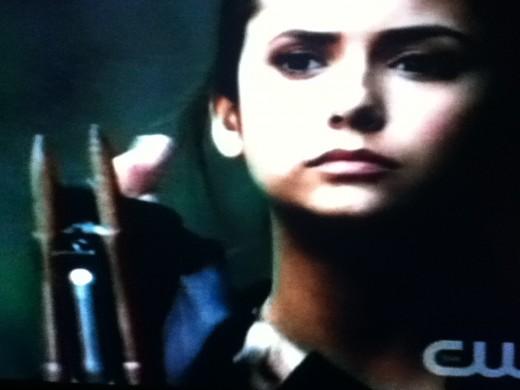 Elena prepares to defend herself against her vampiric ex-boyfriend.