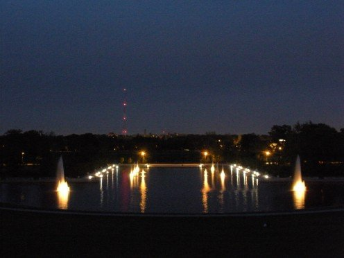 Night time in Forest Park.  Fountains are lit up.  This is actually a very huge set of fountains.  The largest in the park with beautiful grassy hill area surrounding.