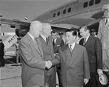 President Dwight D. Eisenhower and Secretary of State John Foster Dulles greet President Ngo Dinh Diem in Washington, D. C.