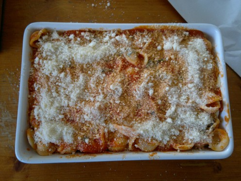 Layer tomato/pasta, sauce and Parmesan cheese.