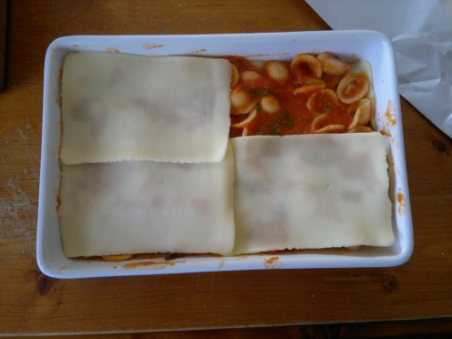 Layer with Mozzarella cheese.