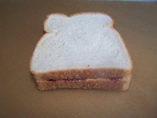 Assume the whole pb & j sandwich is a perfect square and let's find its area.