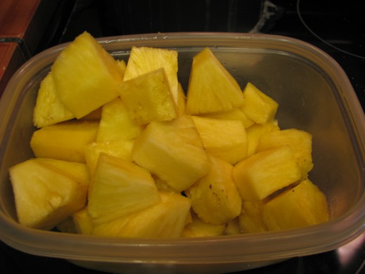 Cut 1/2 fresh pineapple (or one can of pineapple chunks) To cut fresh pineapple: Cut off top and bottom of fresh pineapple.  Slice in half and then quarters.  Cut out  core and then slice each quarter in three.  Cut chunks.