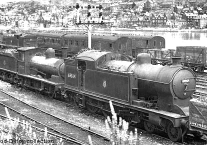 Whitby yard with A8 4-6-2 tank and either J21 or J25 tender loco in front of vintage triple doll signal