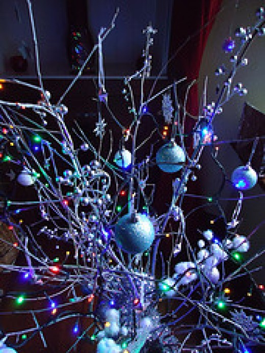 Homemade Christmas Tree by BrockVicky Garden twigs and reusable ornaments create an updated blue Christmas tree