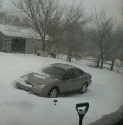 The blizzard like conditions left drifts like the one around my car.  The snow was up to the window ledge on the passenger side, over the trunk in back and yet the ground was showing on the driver's side.