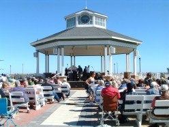 Rehoboth Beach Bandstand is approximately a 1/2 mile north of Silver Lake. If one walks to the south end of the boardwalk and turns right they will see the lake straight ahead.