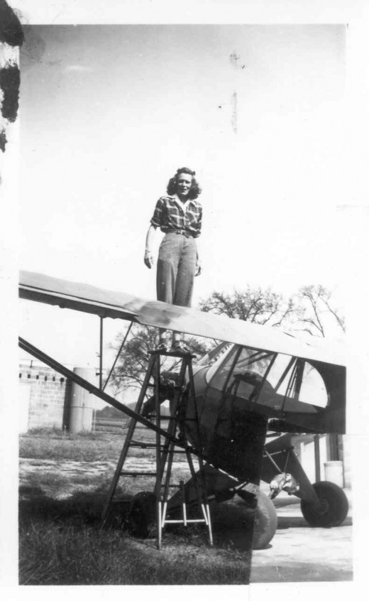 Mary Barnard working on Piper Cub
