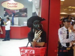An employee of the store try to scare shoppers as they passed by.