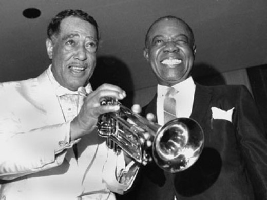 Trumpet: A slightly older Duke with Louis Armstrong, right