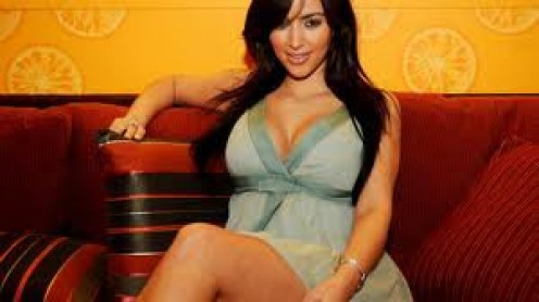 Kim Kardashian should be a guest on Dr. Stork's show.  In this picture, she looks as if she is already on the show!