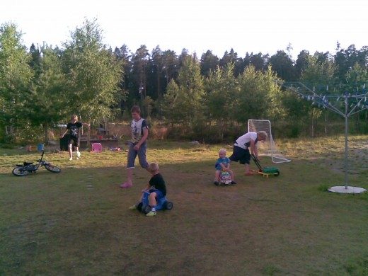 Children playing outside on the countryside in the peaceful country of Finland.
