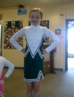 My daughter at cheerleading class.