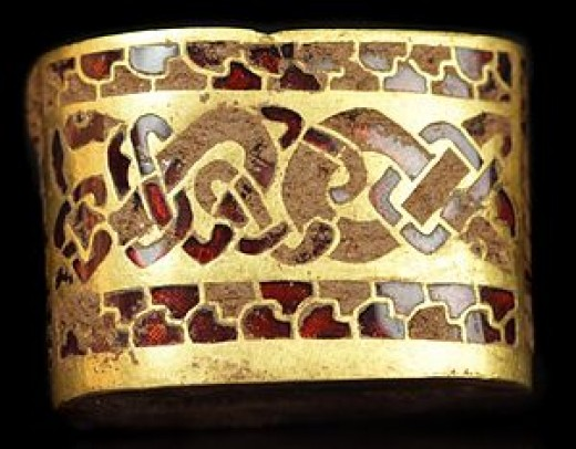 A sword hilt, close-up of the intricate pattern more typical of Northumbrian styles than Mercian, although they were both Anglian kingdoms, as was also East Anglia. Some of the finds were Byzantine from trade or as gifts to the king (Oswald and Oswy)