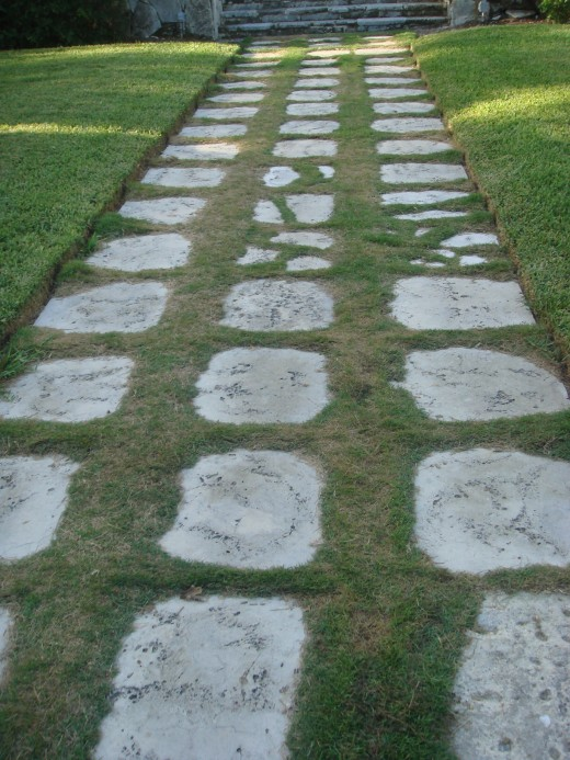 Stone slabs making up the path of the walkway of the cloisters.