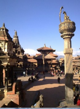 Old Royal Palace Plaza in Patan City. Patan is adjacent to Kathmandu and it is one of the four cities in Kathmandu valley. Kirkpatrick, a British historian, wrote there are more temples than the number of houses and more deities than the people.