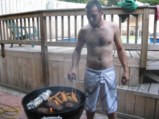 Cory grilling burgers.