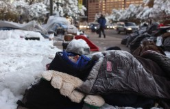 Protesters sleeping on snowny sidewalk in Denver, Colorado. They continue their protests even in the winter snowstorm and freezing night-time temperatures.