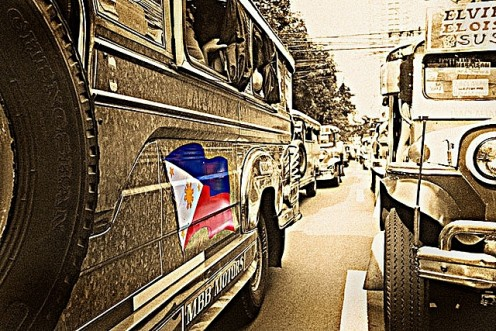 Jeepneys, aptly called the King of the Road and seen here plying the streets of Manila, are the most popular mode of transportation in the  Philippines.