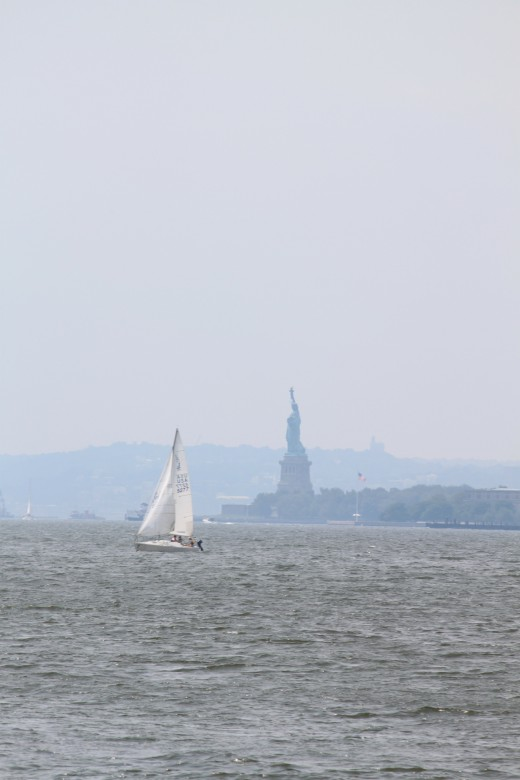 What would be a walk downtown with some kind of view! The Statue of Liberty and sail boat on a hazy day (August 2011)