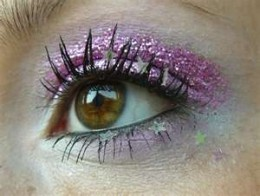 Beautiful violet shadow with a touch of glitter on brown eyes.