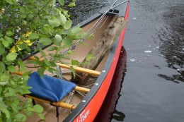 In my canoe, an old portage cart left behind by a careless user.  Please remember to leave the wilderness a better place than you found it.