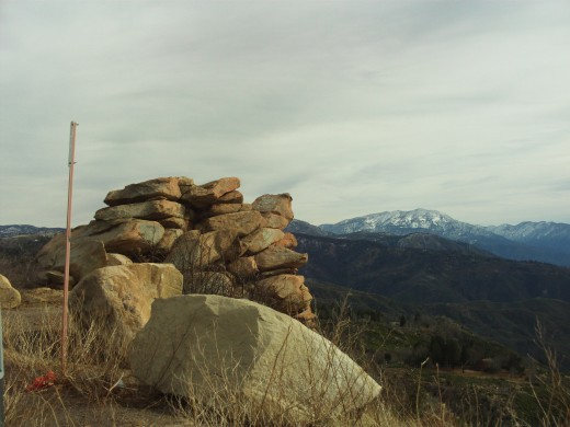 A rock formation on a turnout on the Rim, and the view of Mount San Gorgonio in the distance.