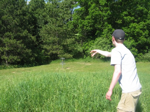 Disc golf drive photo - I like trying to make the disc the focal point of the shot, with the subject just on the side of the frame...this one needed to be a little quicker on the snap to have the disc closer/larger.