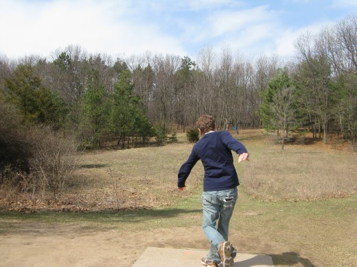 Disc golf drive photo - The contrast of the blue sky against the tree line in this one was the main focus of this shot.