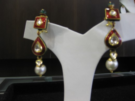 Jadau Kundan Meena earrings studded with diamond polki. Do Posta Meena