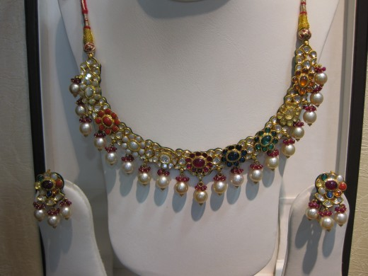 Kundan Meena Navaratna necklace. Navratna represents nine planets in Indian Tantra.