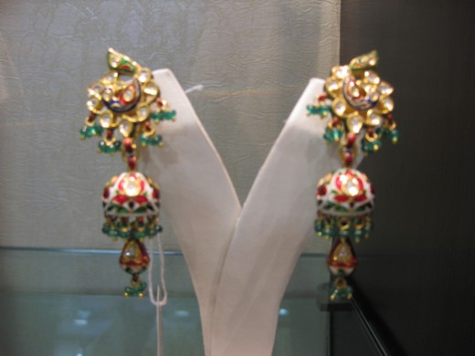 Jhumki (A typical Indian pattern of earrings. Kundan Meena Jadau in gold and diamond polki