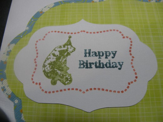 Birthday stamp adhered to cartoche layer on card