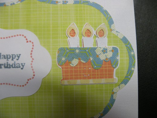 Birthday cake adhered to right side of card